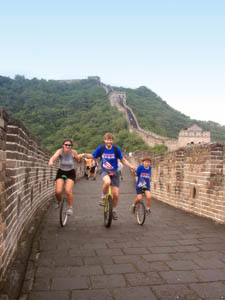 Nathan, Grace and Beau riding unicycles on the Great Wall of China, August 2000